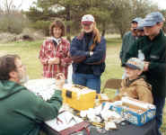 Gathered at banding table; photo by Dorothy Metzler 16Mar02